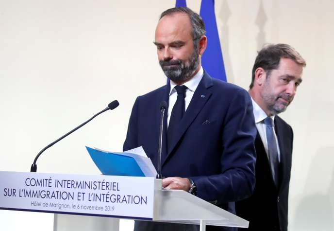 French Minister of the Interior Christophe Castaner and French Prime Minister Edouard Philippe leave after a news conference on immigration at the Hotel Matignon in Paris