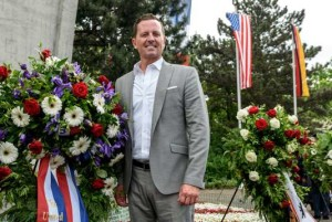 U.S. ambassador to Germany Grenell stands beside a wreath in Berlin