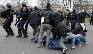 French plainclothes police apprehend youths during a demonstration against police brutality after a young black man, 22-year-old youth worker named Theo, was severely injured during his arrest earlier this month, in Paris